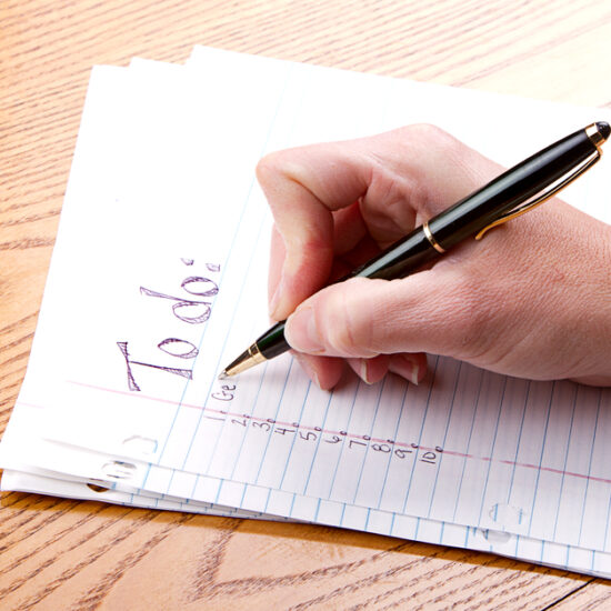 Hand With Pen Writing To Do List